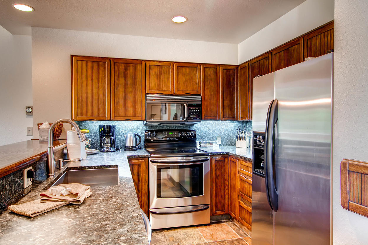 The big kitchen with granite countertops and modern appliances is fit for even the most seasoned chef.
