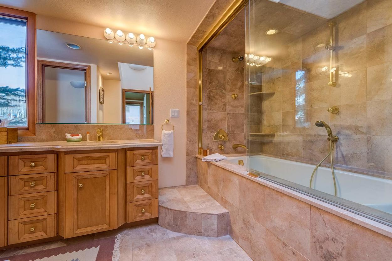 Relax in the combination tub/ steam shower.