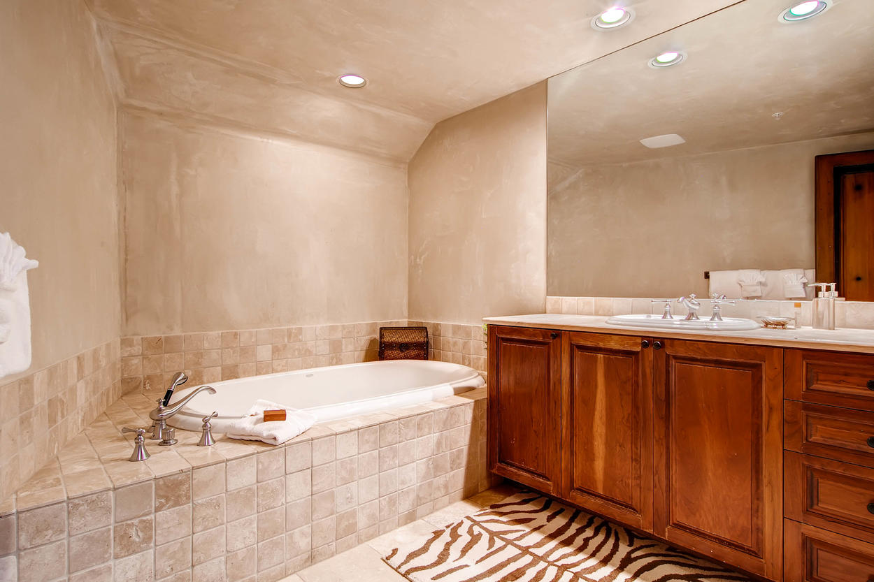 The private bathroom to Guest Bedroom #3 has a jetted tub.