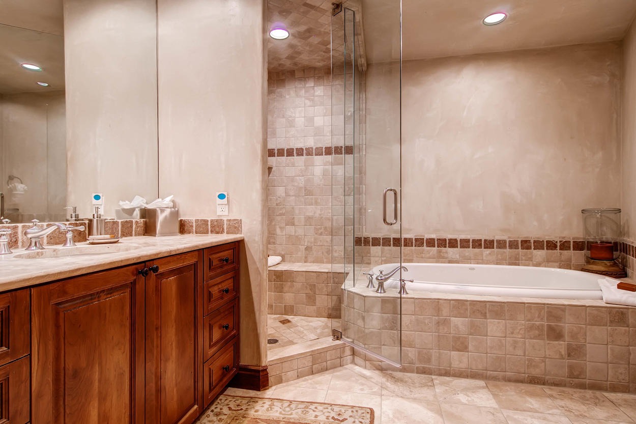 The private bathroom to Guest Bedroom #2 has a jetted tub and separate walk-in shower.