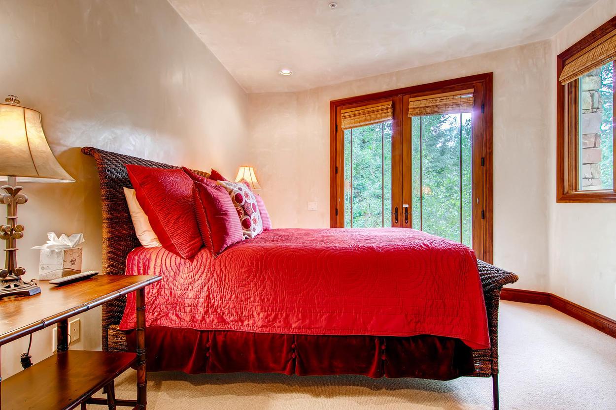 Guest Bedroom #4 has a queen bed.