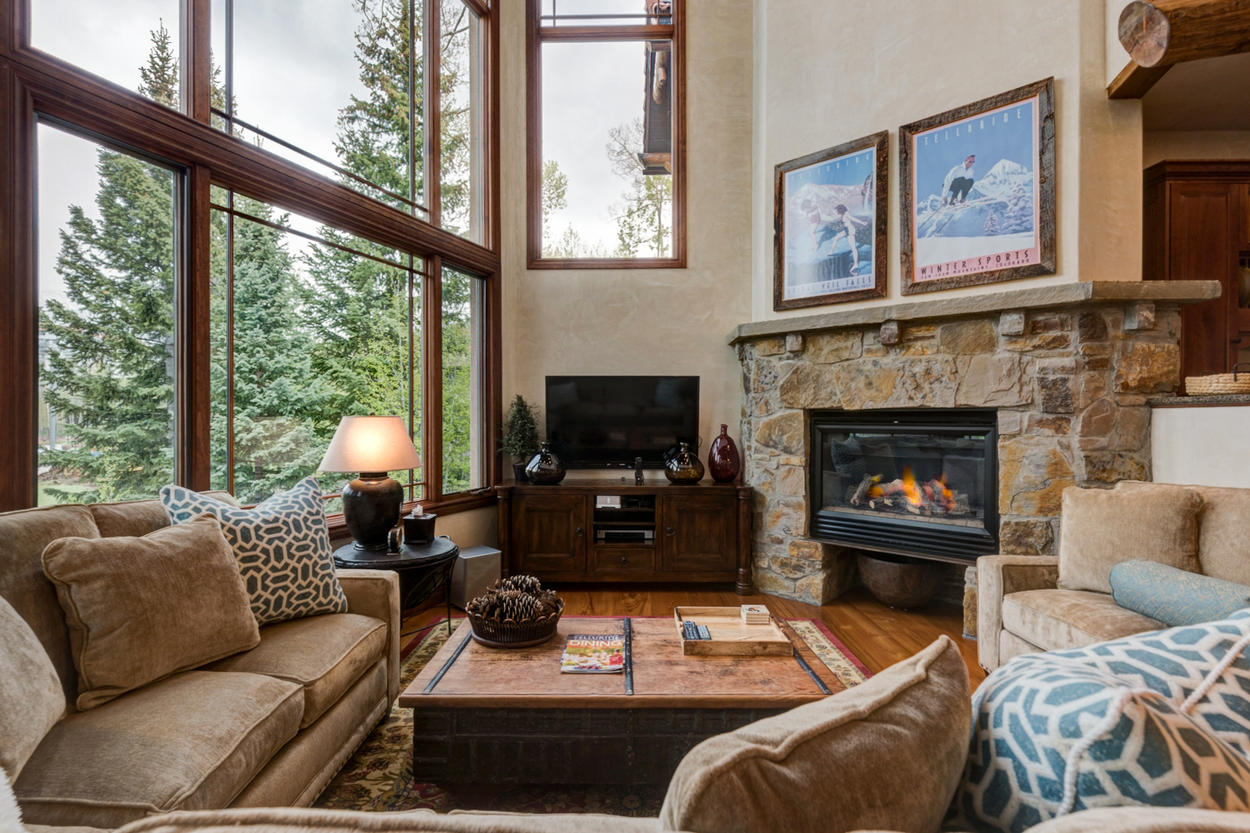 This spacious great room with its gas fireplace, Sonos surround sound, and Apple TV, is the perfect place to kick back and relax with the whole crew.