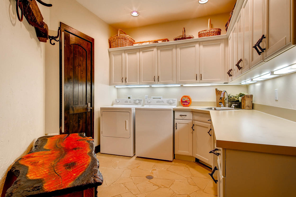 The laundry room on the ground level offers plenty of storage space and a washer and dryer.