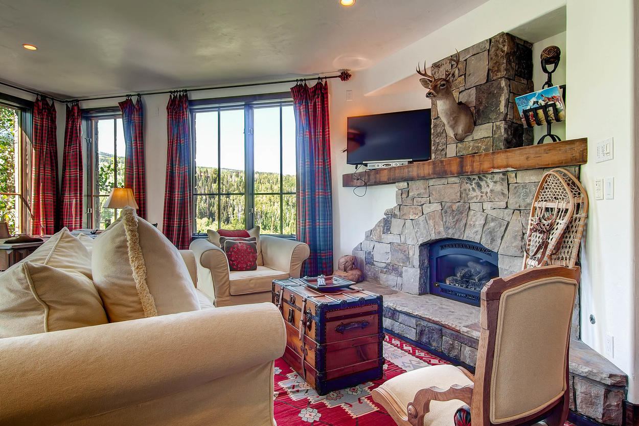 Enjoy the comforts of the fireplace and unobstructed views of the mountain in Master Bedroom #1.