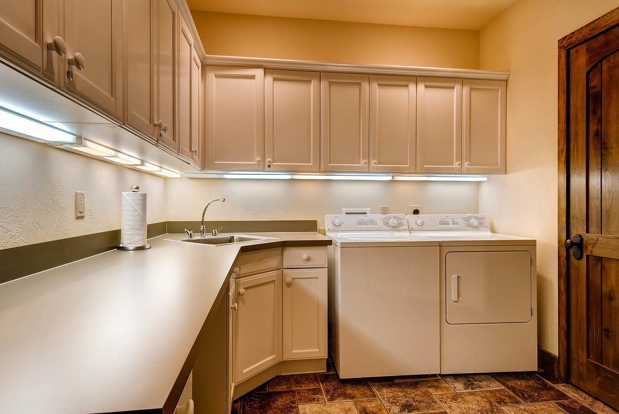 There's a laundry room located on the lowest level with a sink and a washer and dryer for your convenience.