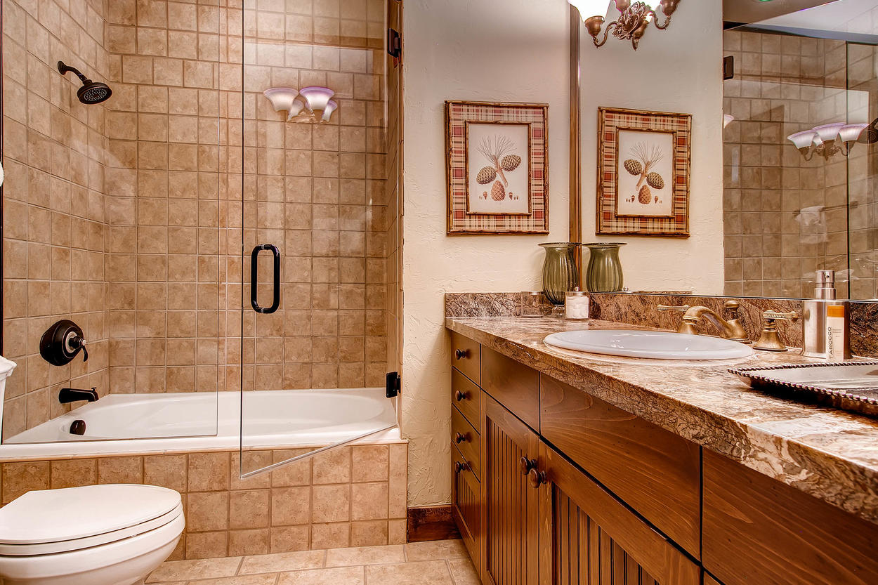 A full bathroom for Guest Bedroom #4 features a tub/shower combo and plenty of counter space.