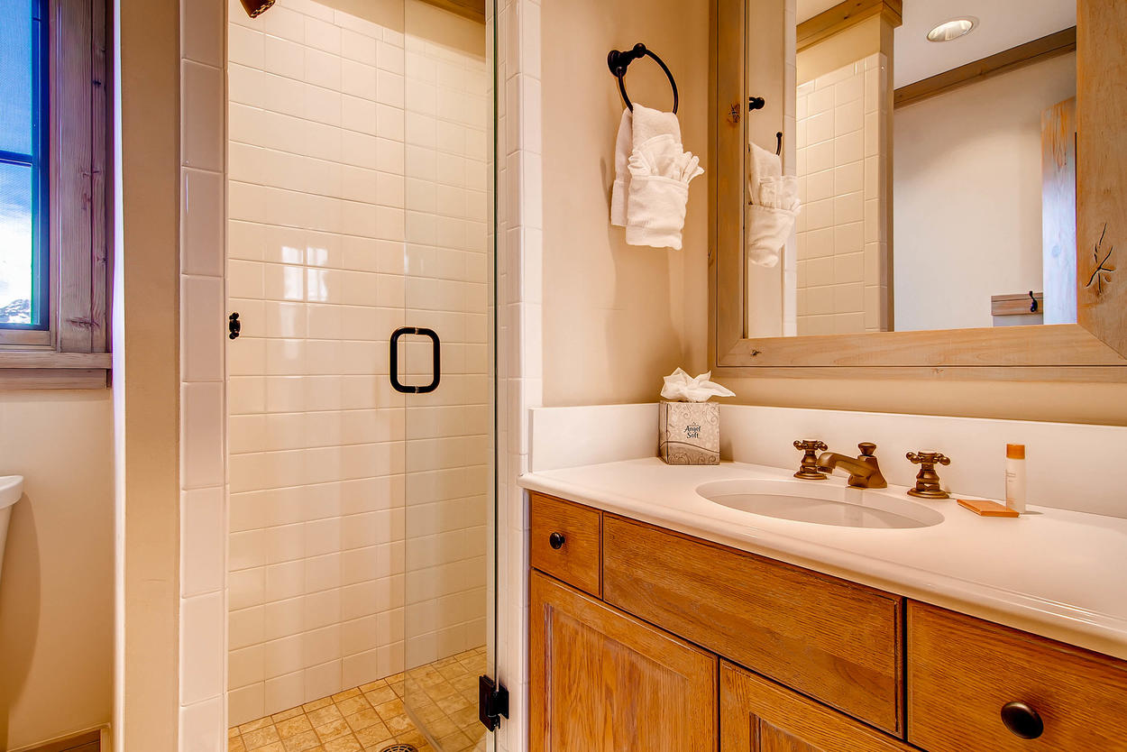 The twin Guest Bedroom 5 has an ensuite as well with single sink vanity and a walk in shower.