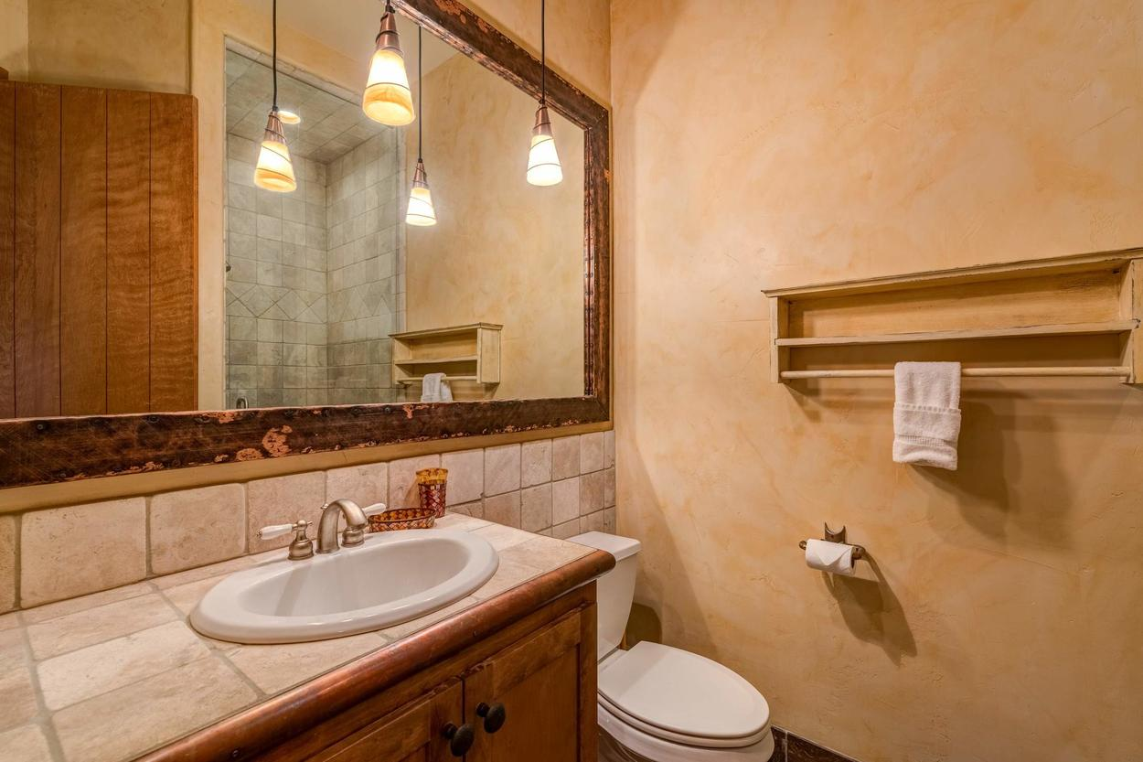 A second full bathroom features a walk-in shower and single sink vanity.