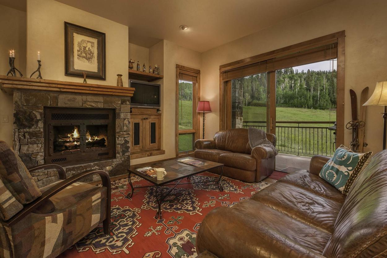 There's plenty of seating by the fireplace to warm up after a day out exploring. There's also a sleeper sofa for a kid or two.