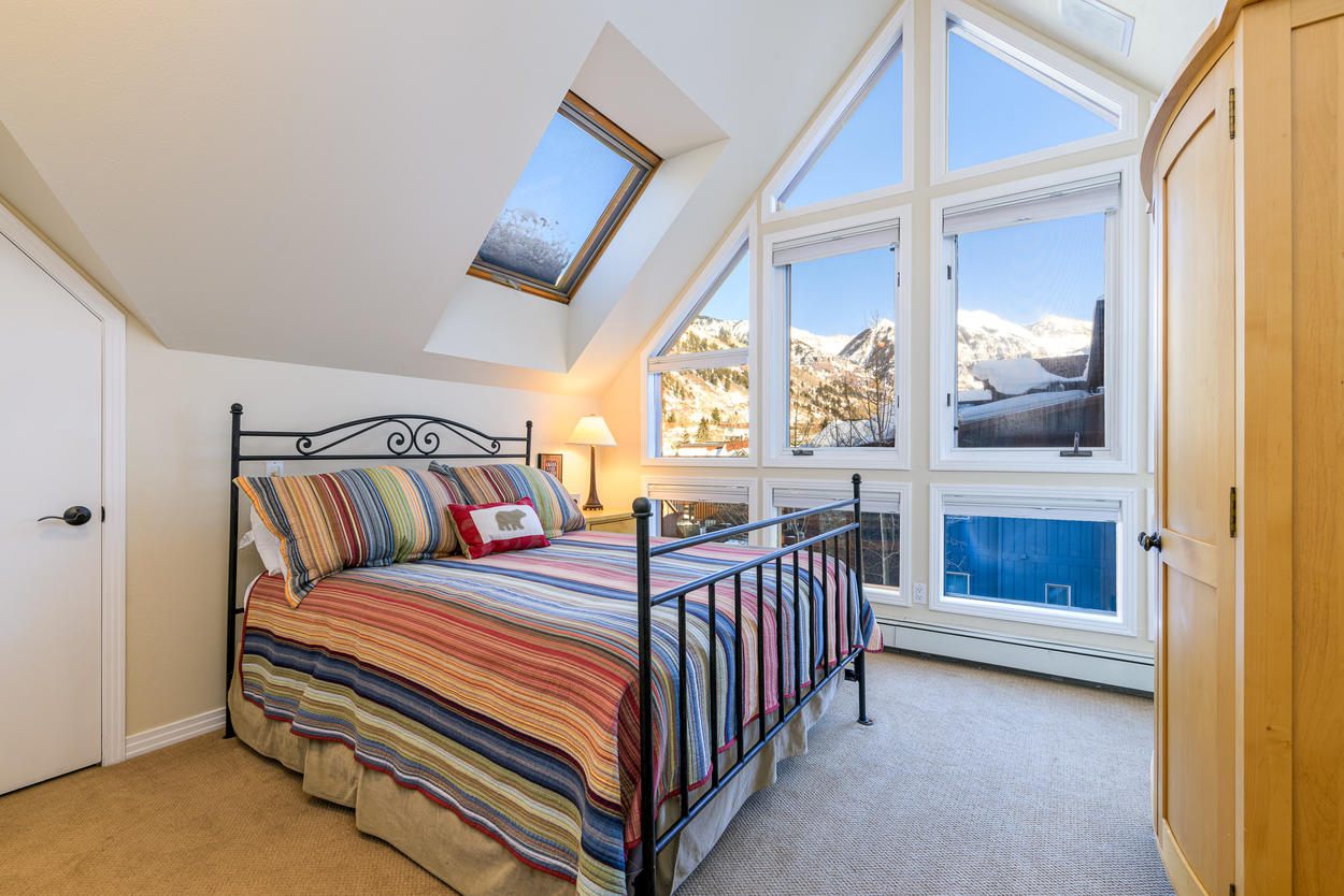 Guest Bedroom #2 features high vaulted ceilings, skylights, and great views of the town.