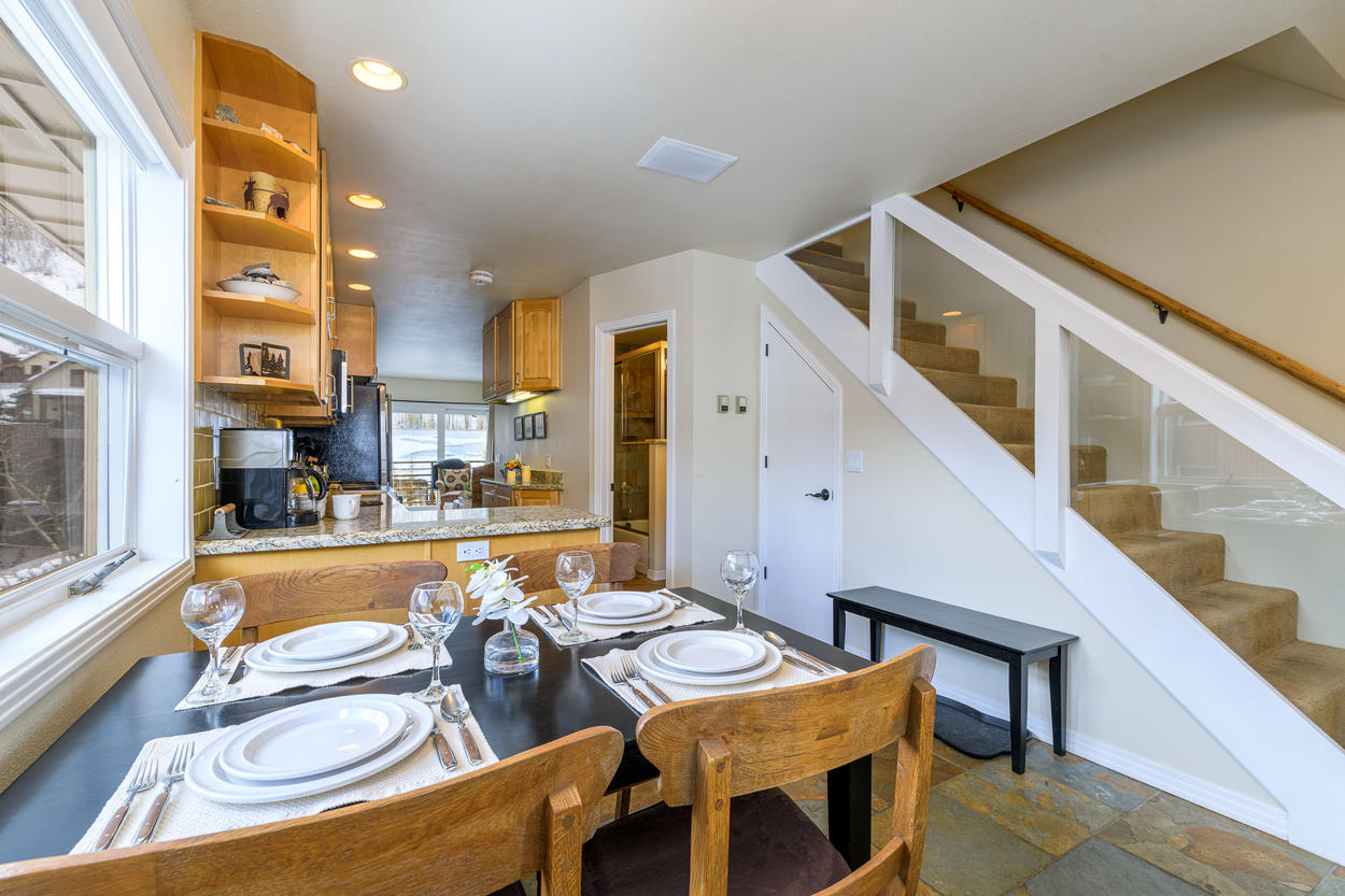 From the dining area, head upstairs to find two bedrooms and an additional bathroom.