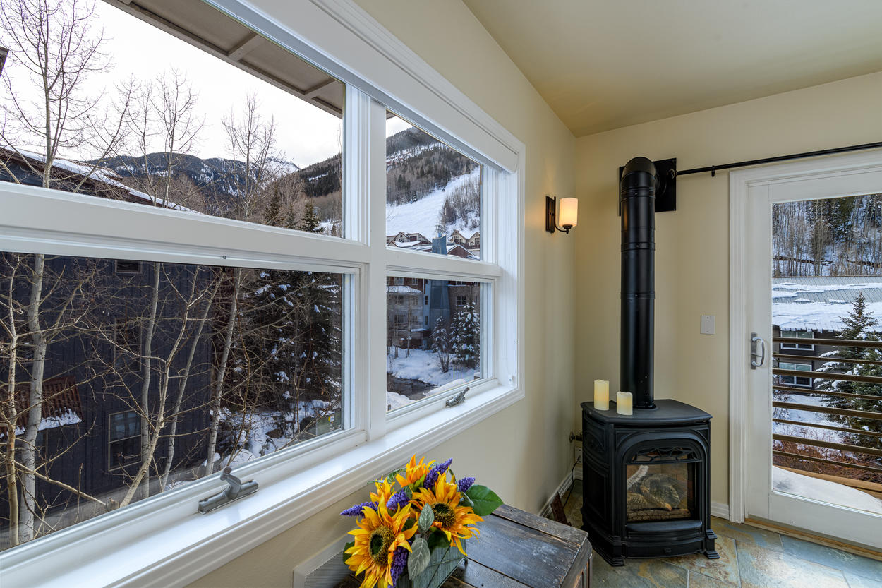 Gaze out at the slopes through the large living room picture windows next to the heating stove.
