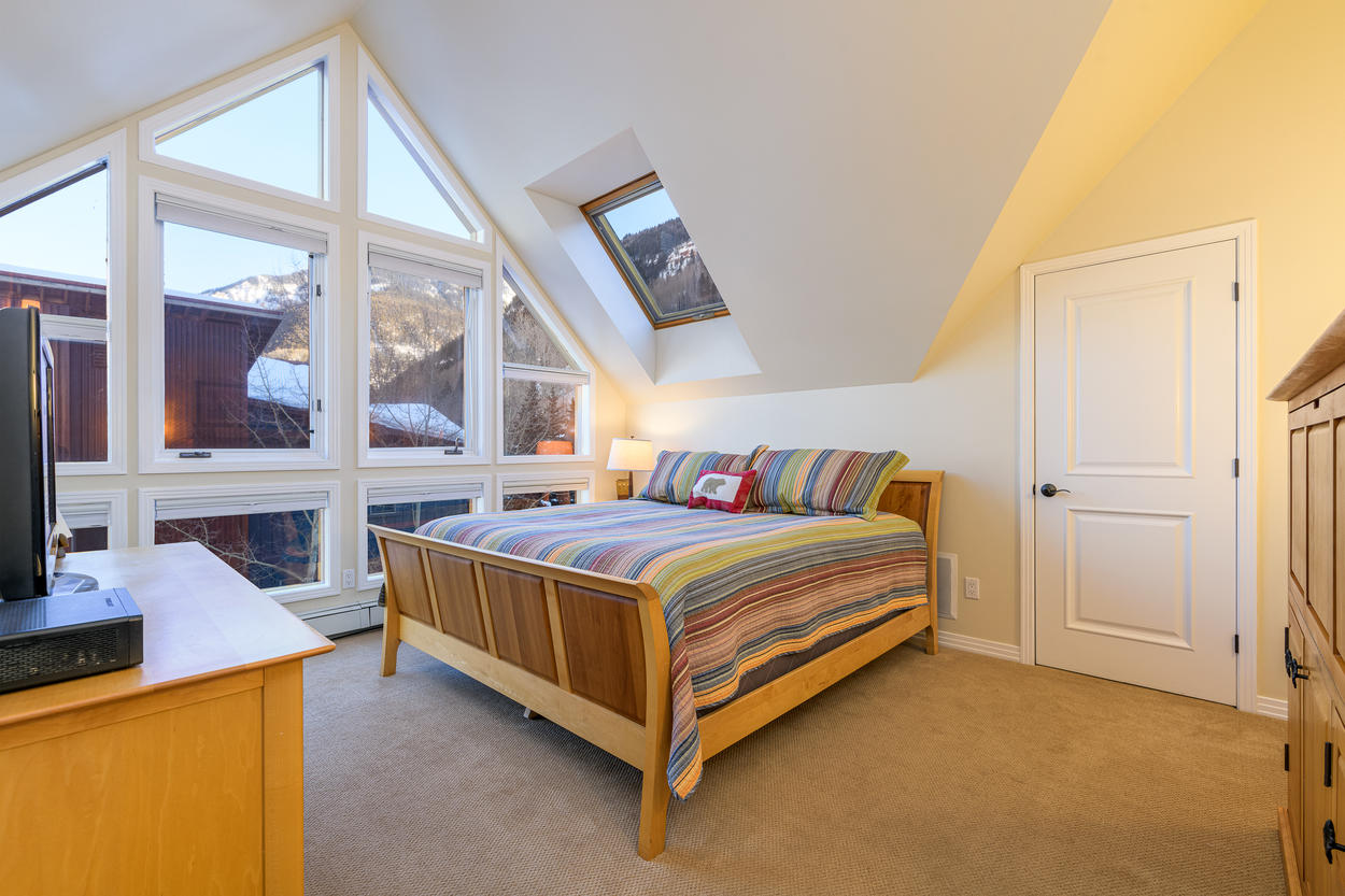Master Bedroom #1 has a king bed, high vaulted ceilings, and great views of the end of the valley.