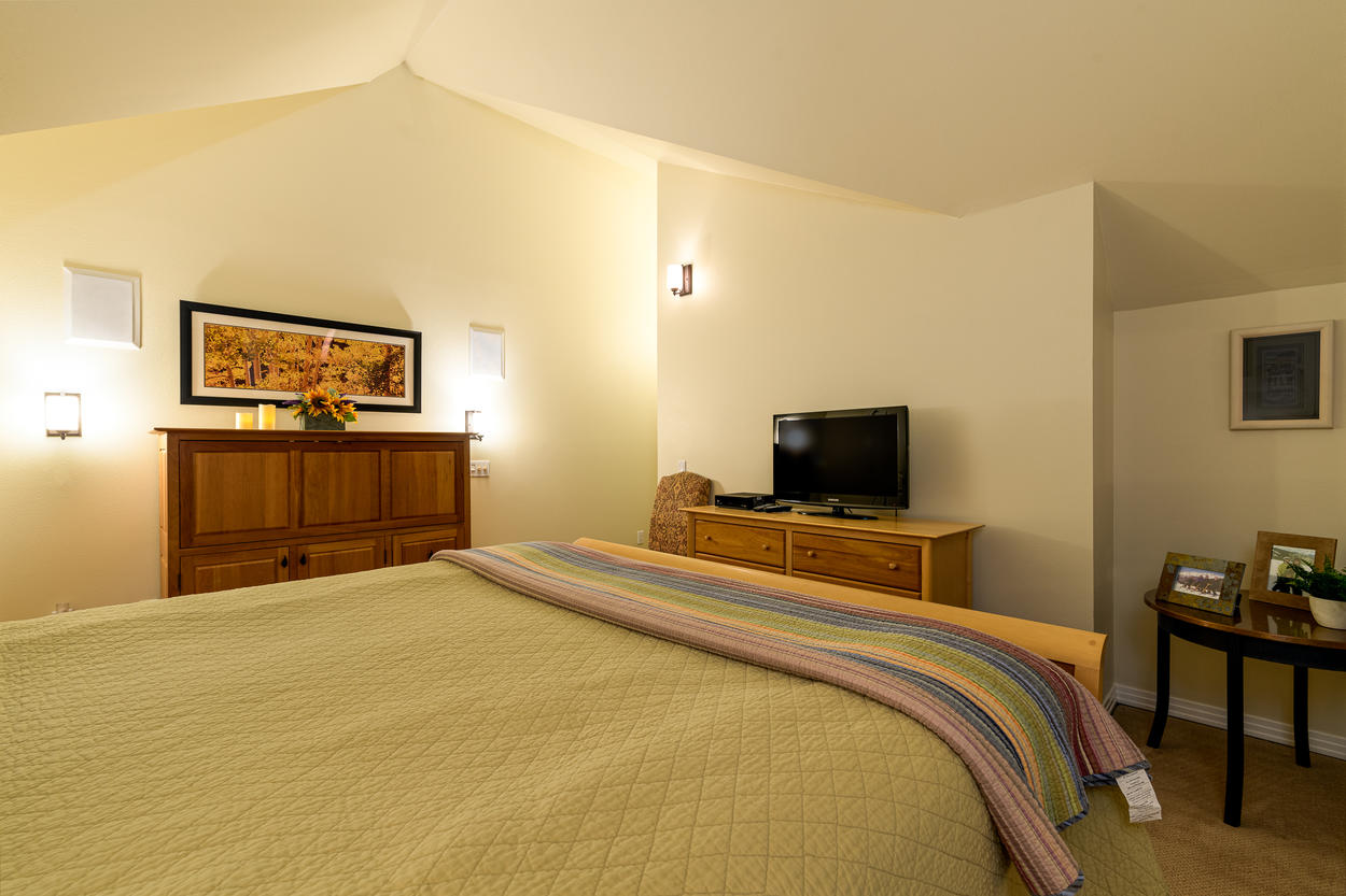 Master Bedroom #1 features a TV and private ensuite bathroom.