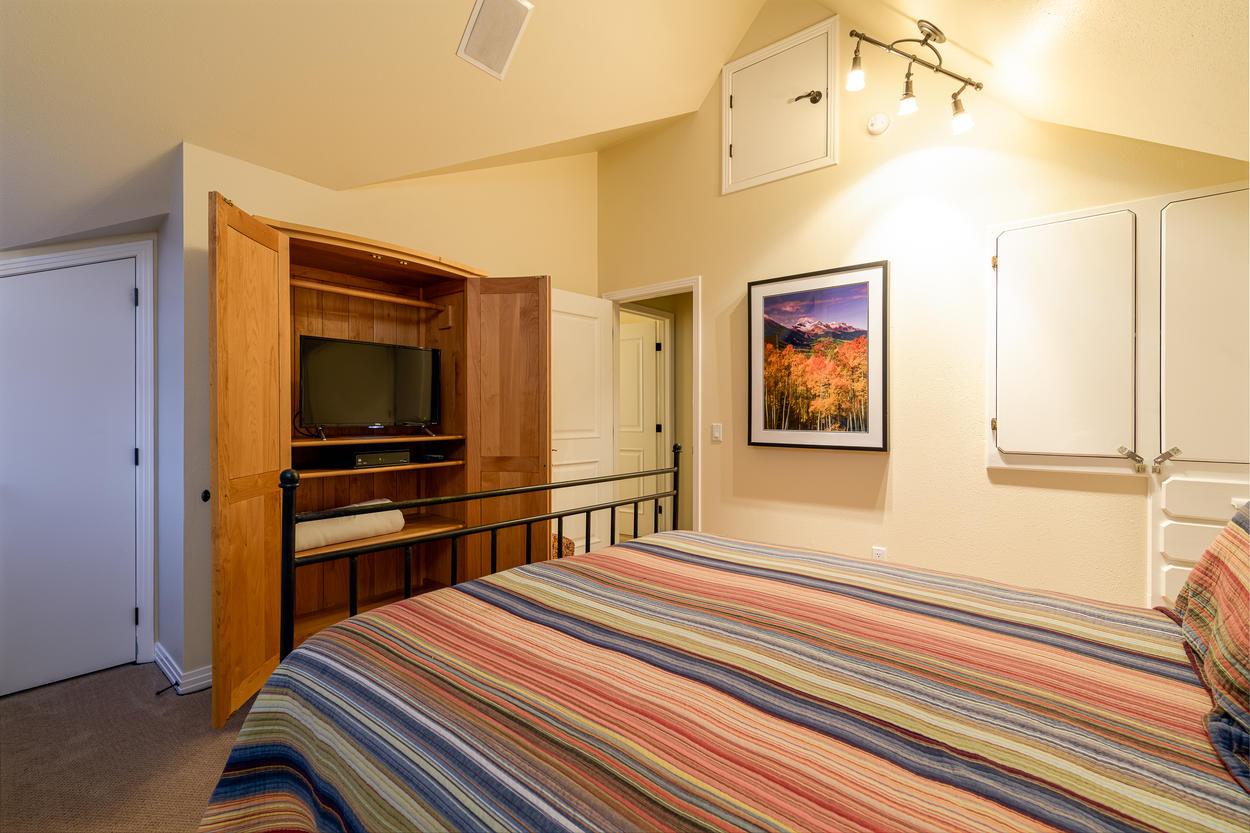 Guest Bedroom #2 has a queen bed and TV.