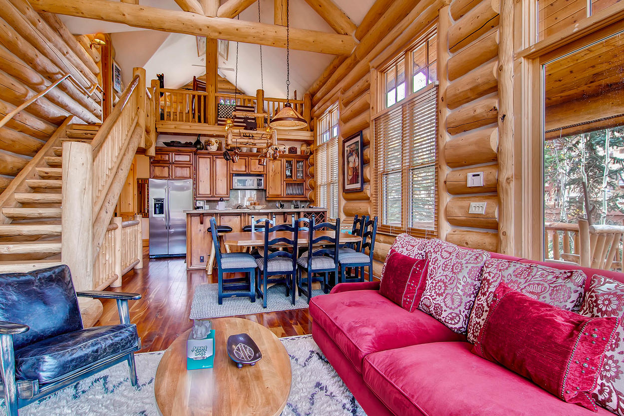The open concept floor plan with a log cabin feel makes this home a great mountain getaway.