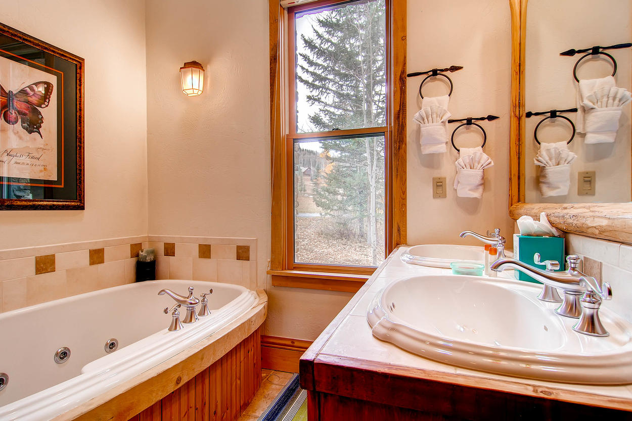 The Master Bedroom has an ensuite bathroom featuring a soaking tub and double vanity.