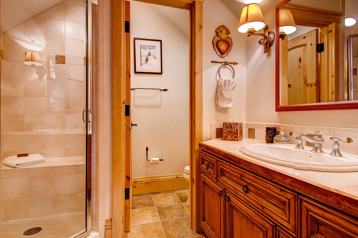 The private bathroom for the Loft Bedroom features a walk-in shower and private toilet room.