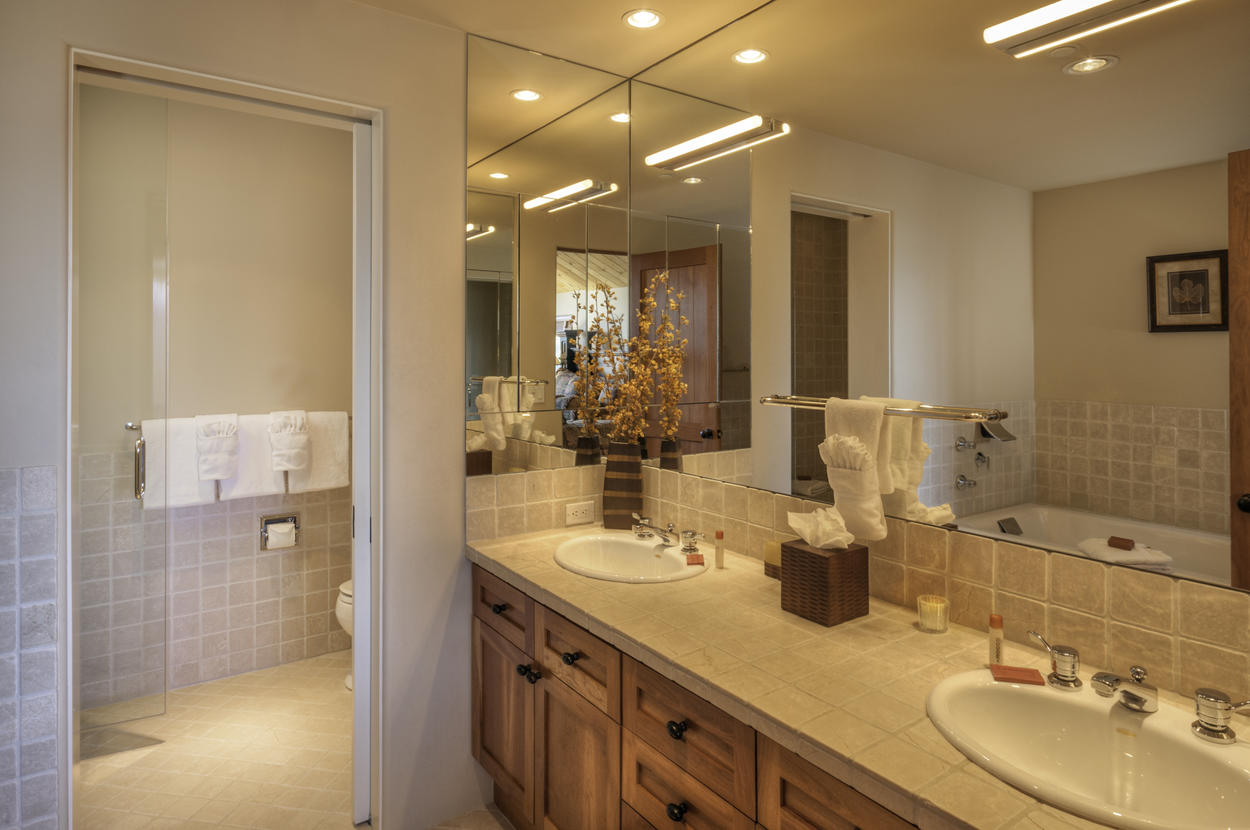 The master bathroom is decked out with dual vanity, walk in steam shower and a massive jetted tub.
