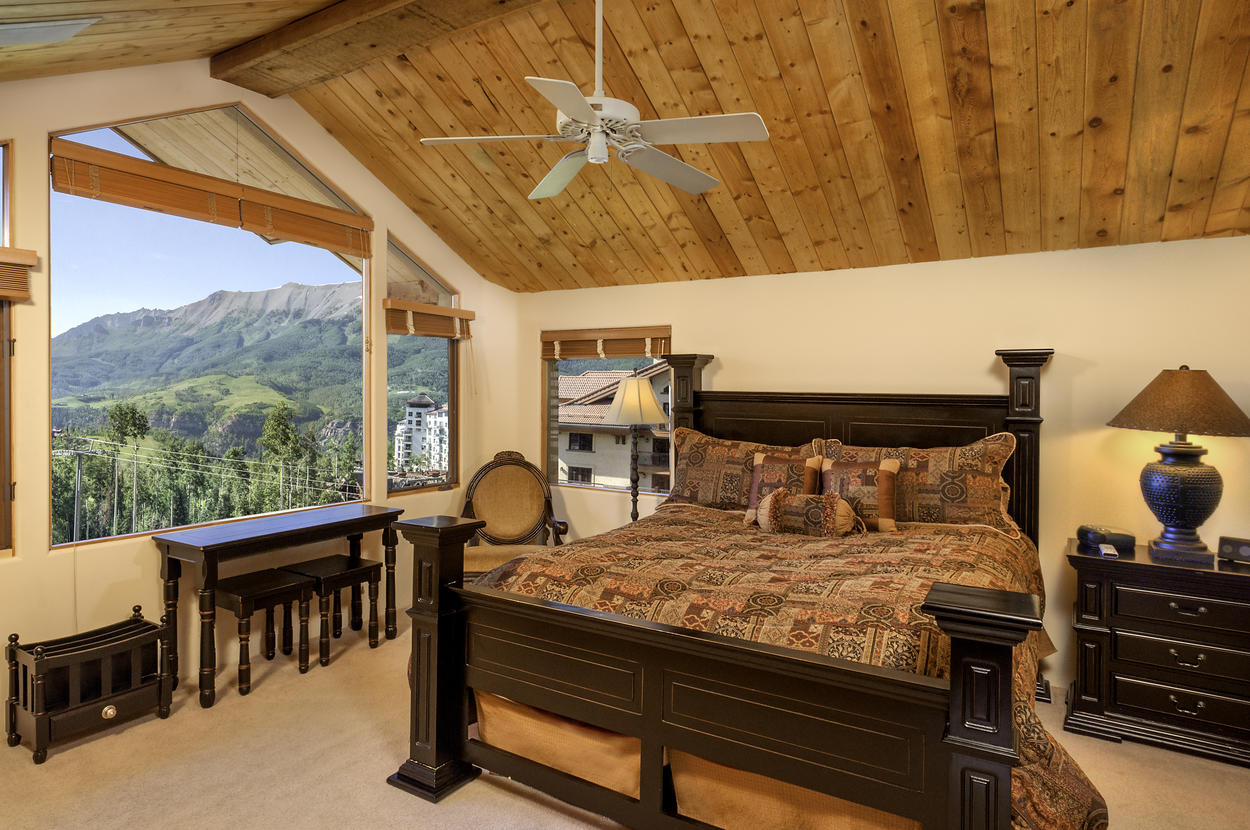 Yet another room with a view! Guest Master Bedroom #3 is located upstairs and features a king bed and ensuite bathroom.