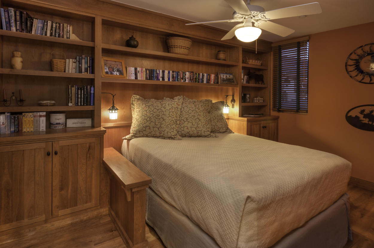 Guest Bedroom #2 is located on the main level off the kitchen and living room and features a queen bed.