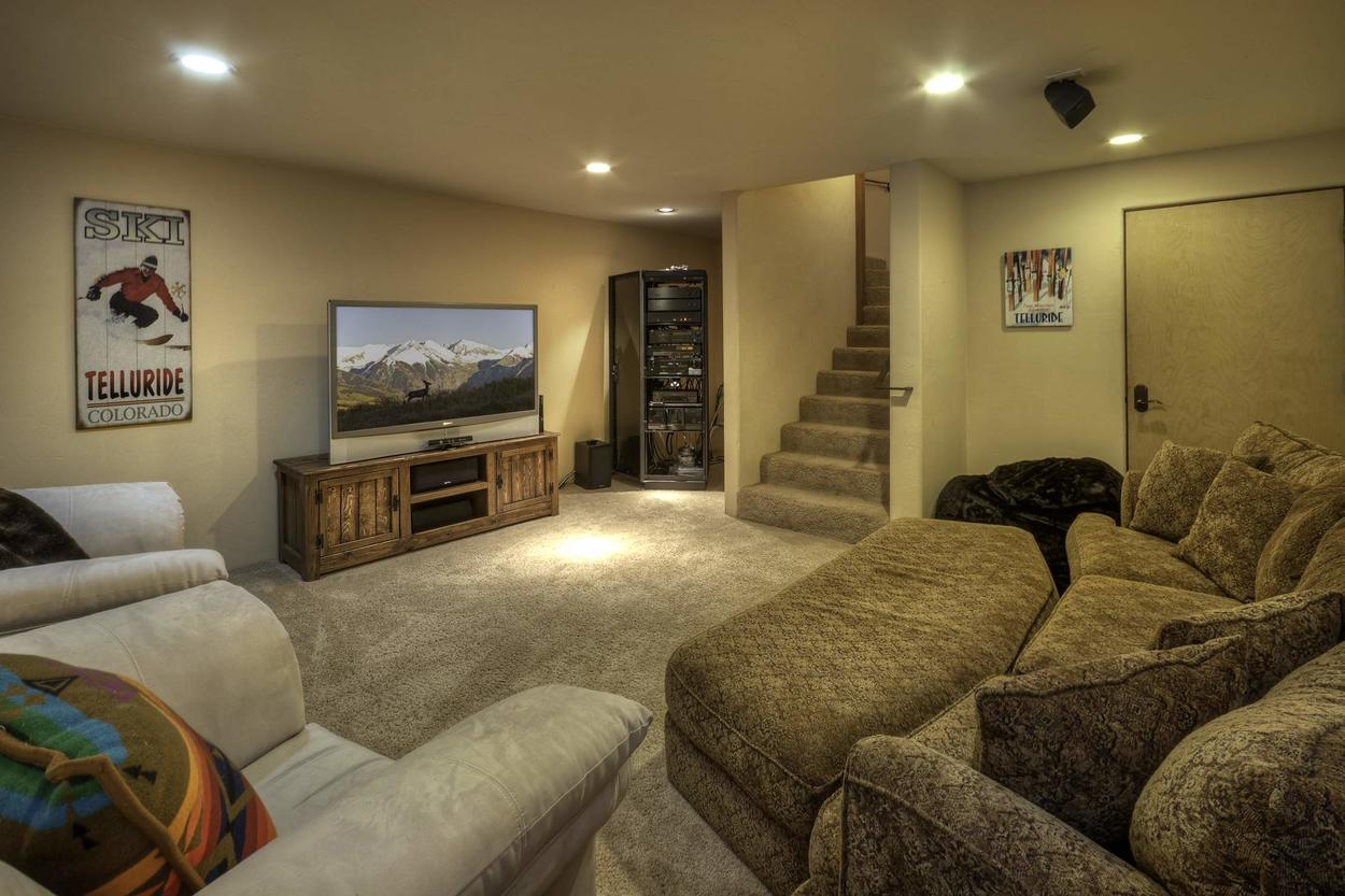 The downstairs media room is a great place for the kids to watch TV while the adults enjoy a glass of wine in the hot tub.
