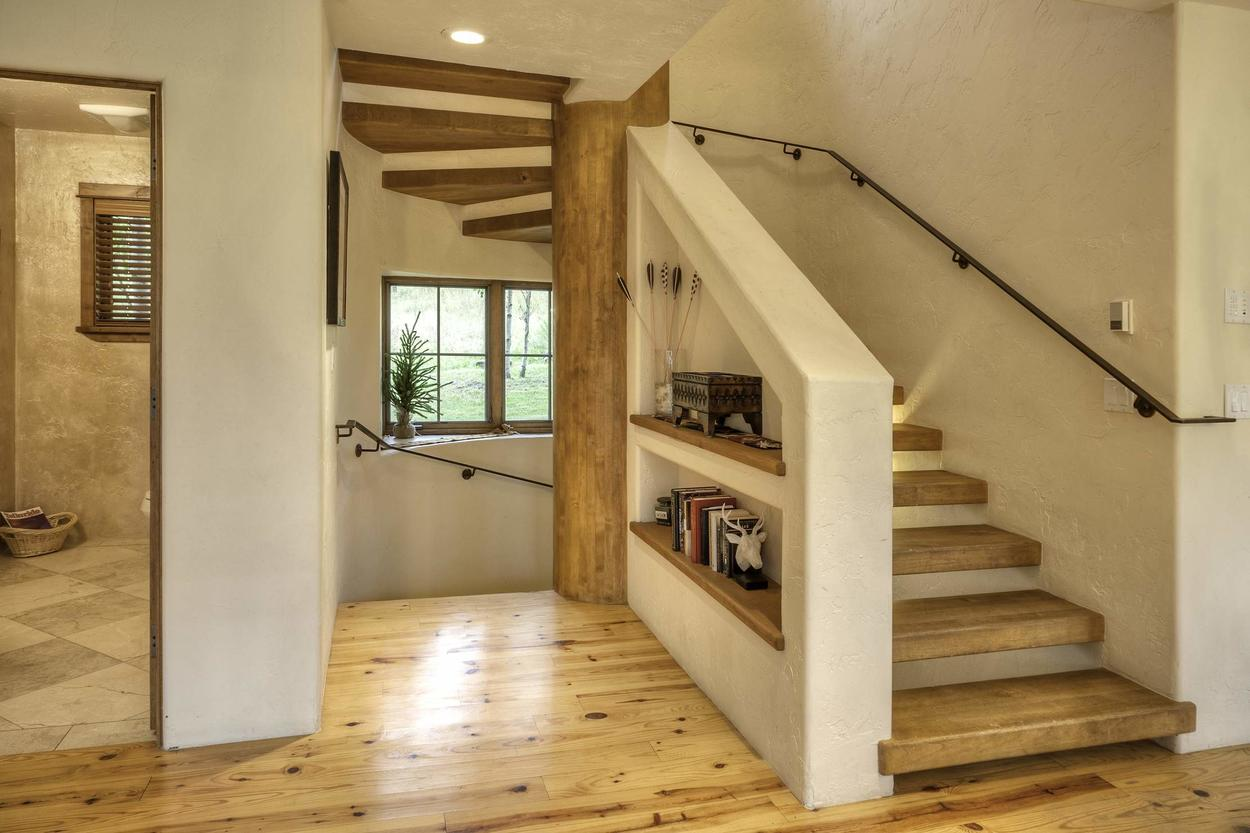Venture up the stairwell from the main level to the upstairs where you'll be sleeping after the fun and games are over.