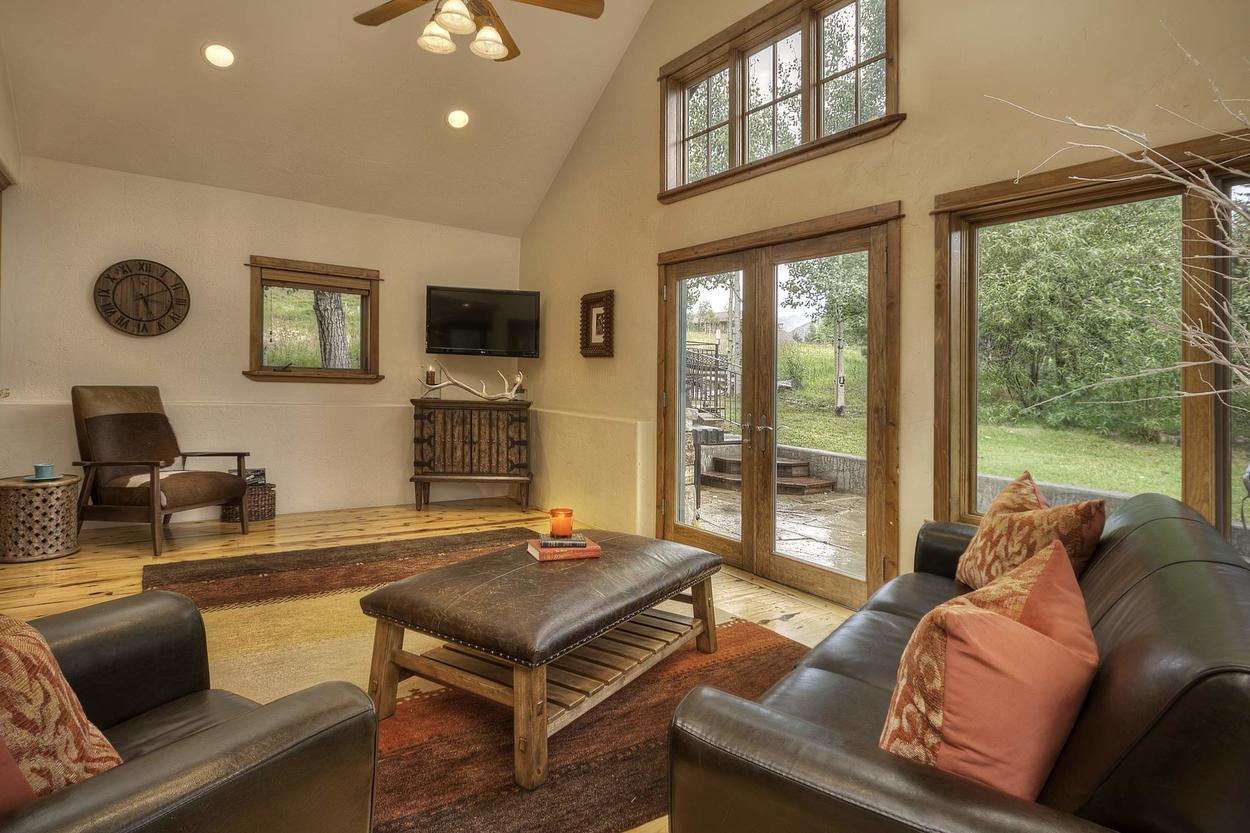 Keep the kids close while you cook up dinner in this sitting area adjacent to the kitchen and patio.