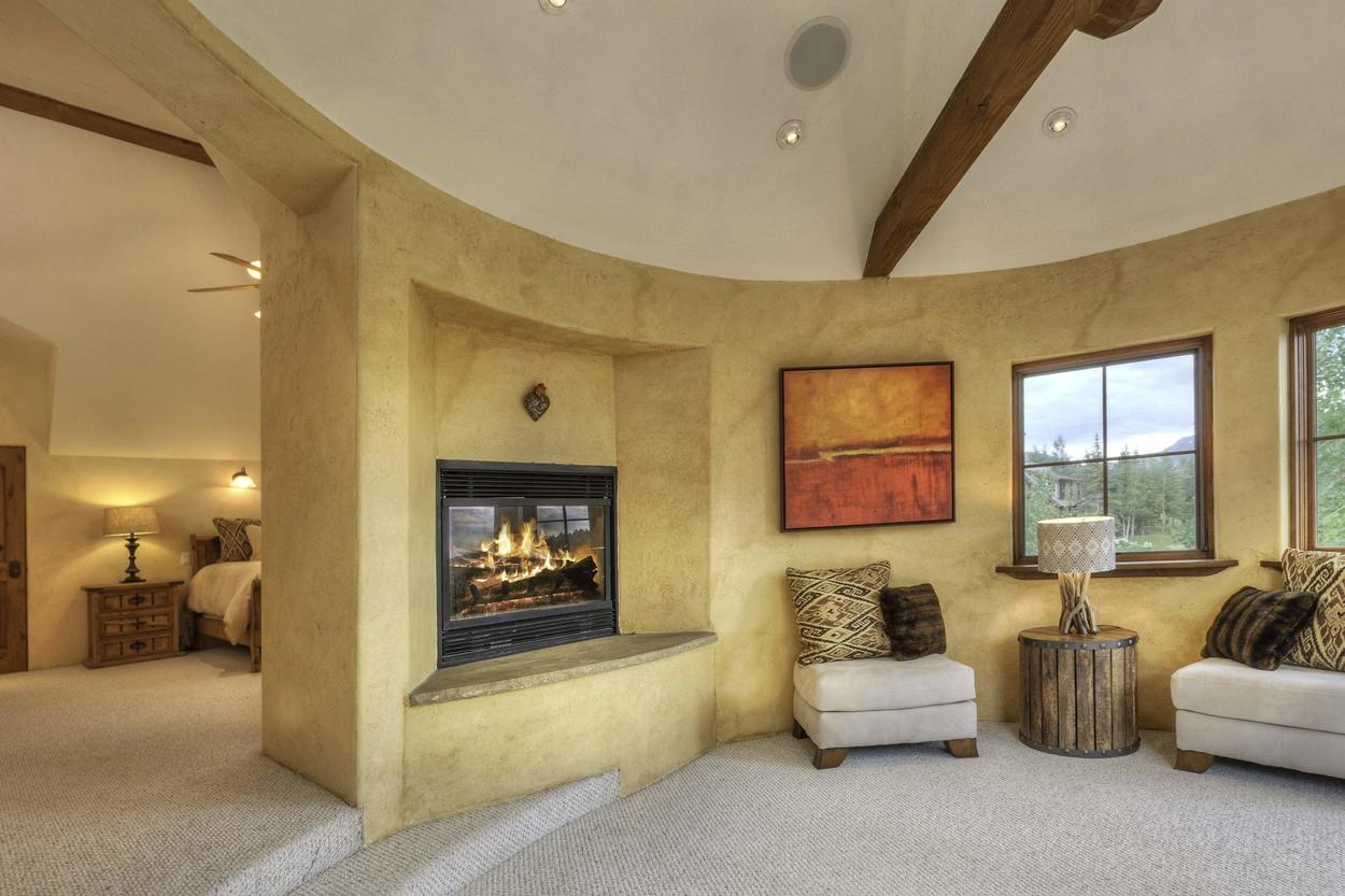 Escape from the family in your private master sitting area with a gas fireplace.
