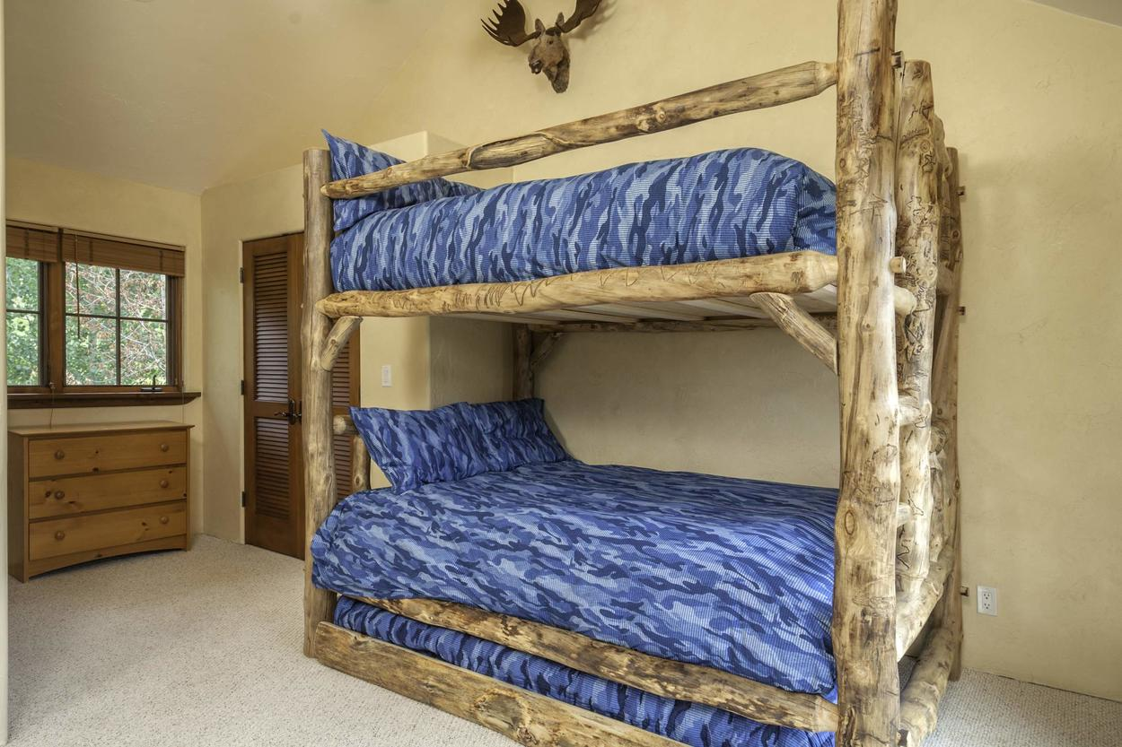 The third floor bunk bedroom has plenty of space for all the kiddos with two full size bunks (and a trundle). Best of all? The room has it's own en-suite-no sharing with Mom and Dad.