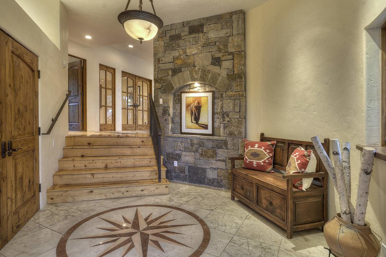 The elegant entryway is well-appointed and sets the tone for the whole home.