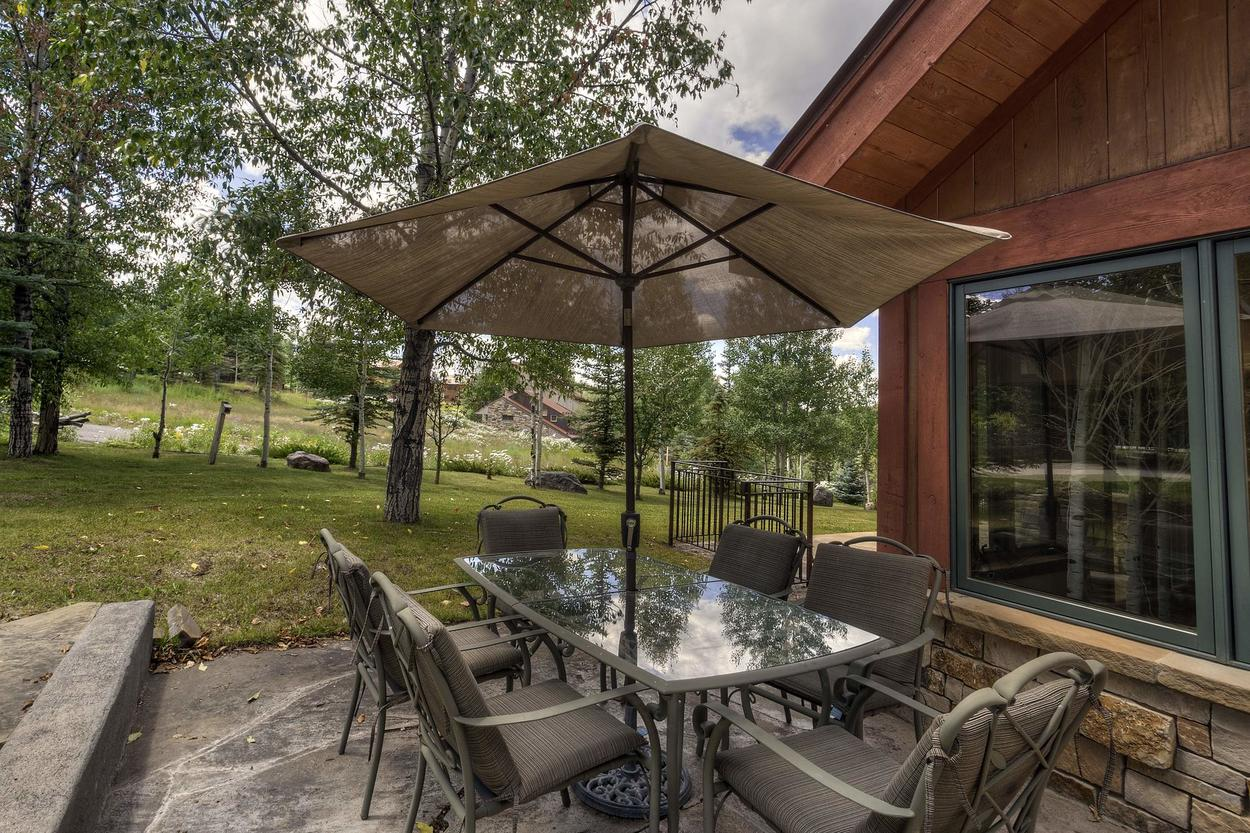 Grill up a steak for you to enjoy at the outdoor patio table.