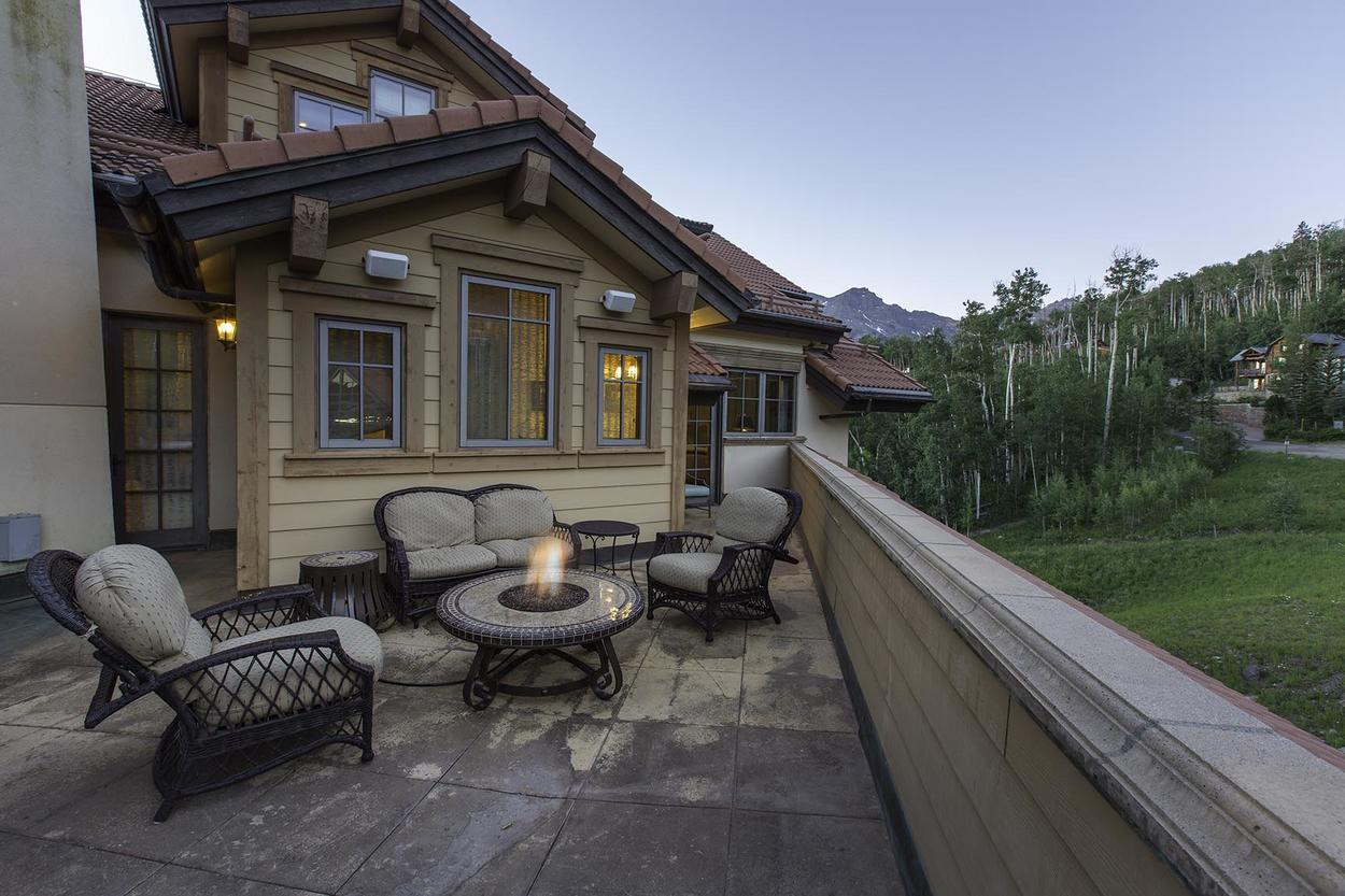 Enjoy a seat out by the firepit on the deck.