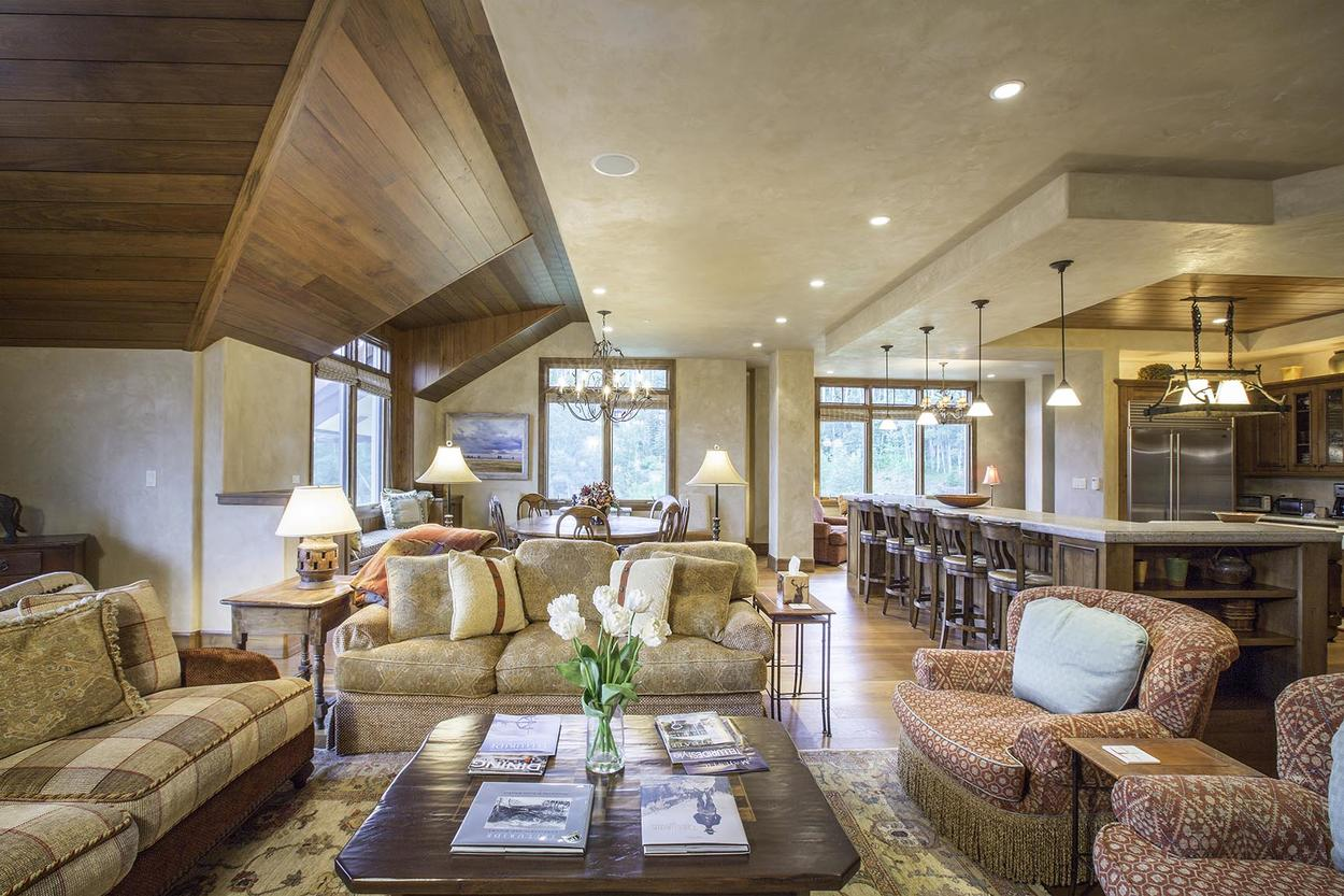 The open concept living space and high ceilings give this condo a very grand feel.