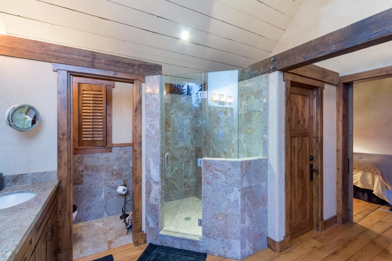 The master bathroom has a separate toilet room and a walk in shower.
