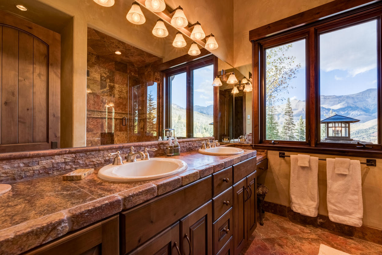 This ensuite has a dual sink vanity and, of course, another angle on your beautiful mountain view.