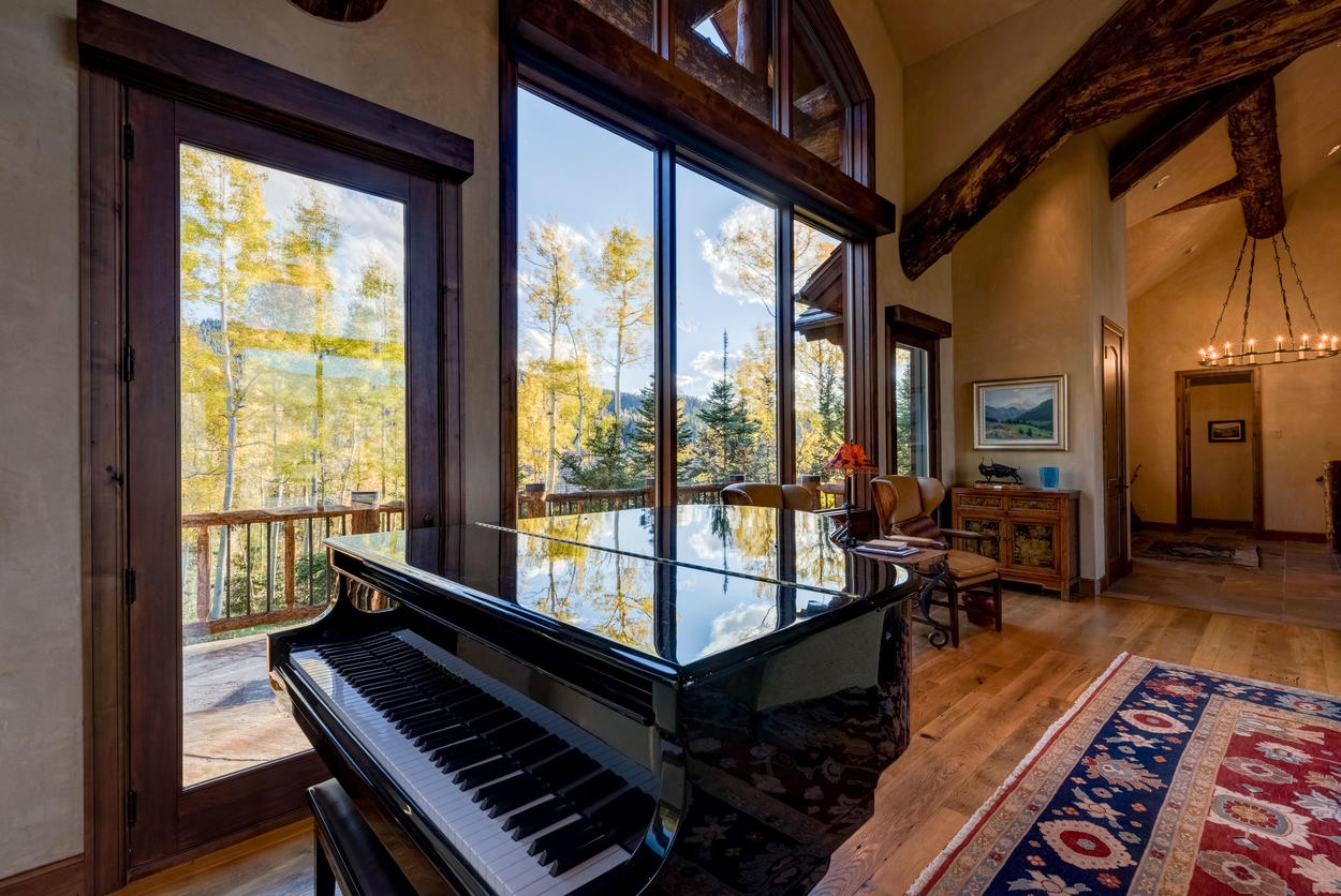 Tickle the ivories on the grand piano in the living room for added ambiance.