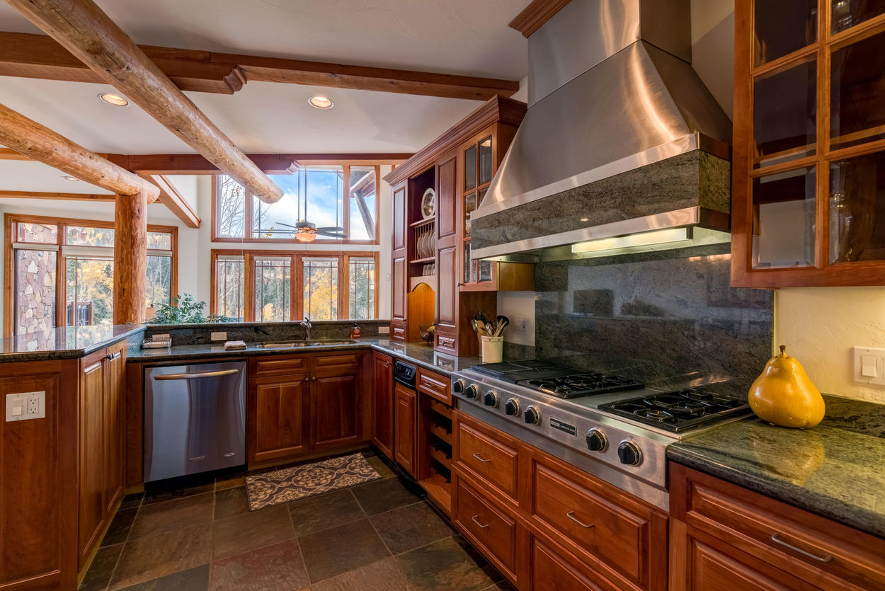Commercial-grade appliances and plenty of granite counter space to certainly will make the chef smile