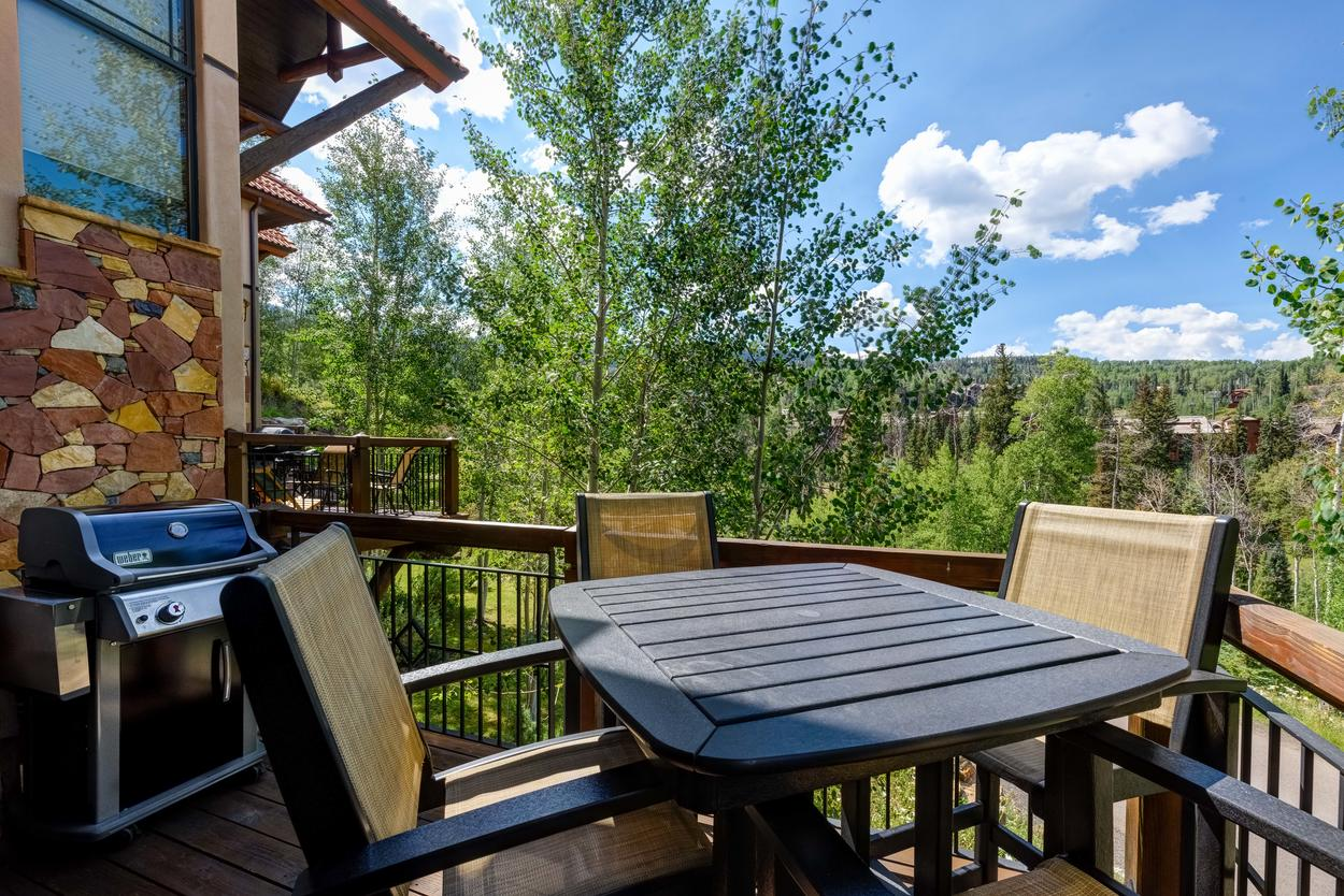 Lounge on the patio with dining for four and a gas grill, while taking in the stunning views