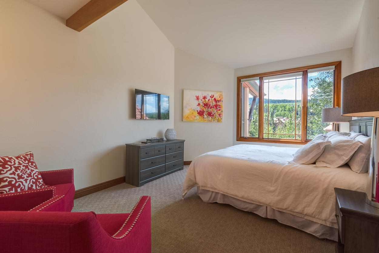Junior Master King Bedroom with two armchairs, private Ensuite with soaking tub, walk-in shower and dual vanity
