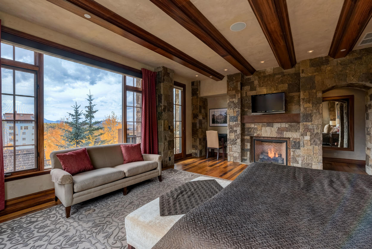 In the master bedroom, enjoy the cozy fireplace, TV, and private desk nook.