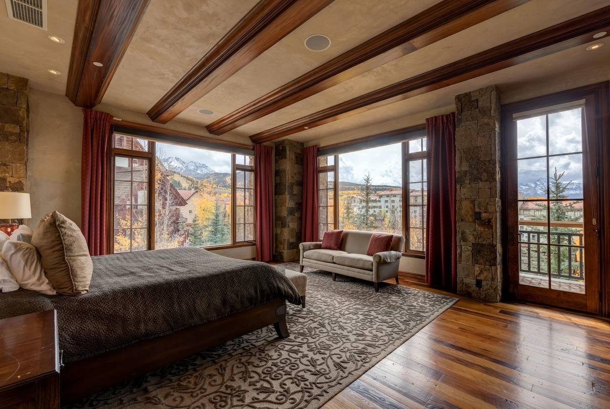 Enjoy majestic mountain views from the master bedroom and plenty of seating both inside and out.