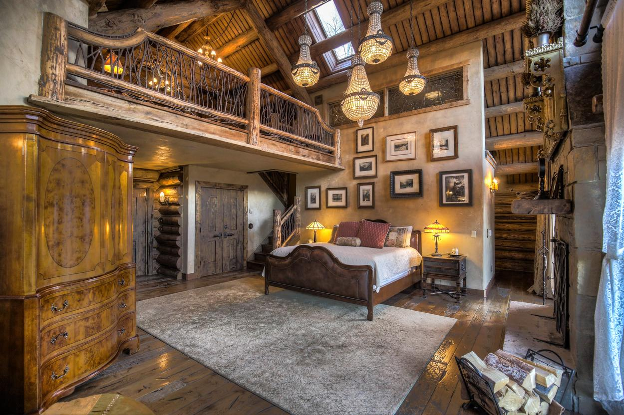 The master bedroom features a king bed and beautiful log ceilings.