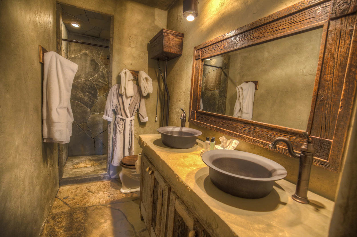 The ensuite bathroom features a walk-in shower and double vanity.
