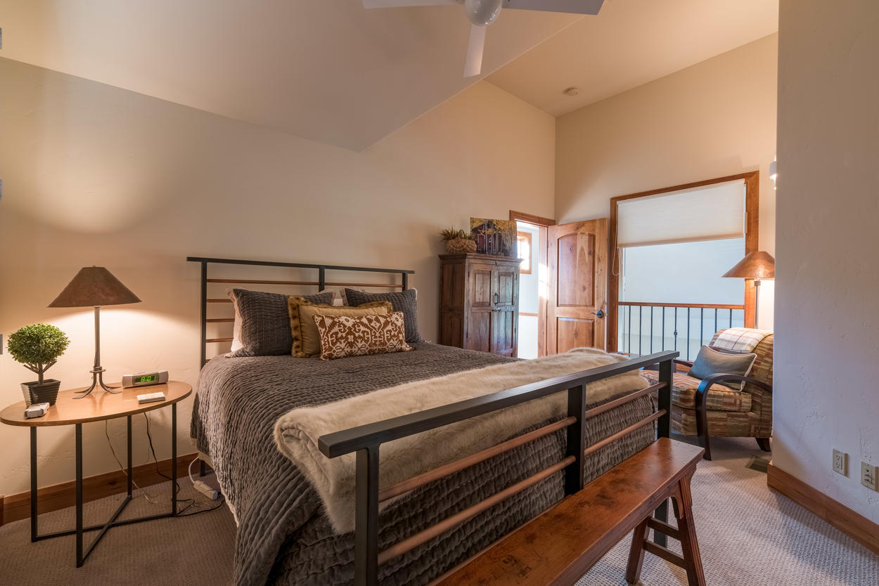 The top-level Guest Bedroom 2 features a queen-size bed and ensuite bathroom.