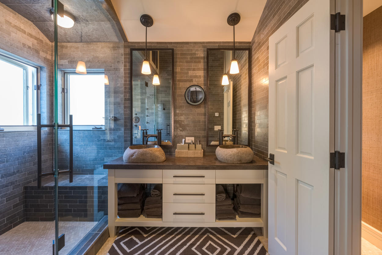 There's room for two to get ready in the master ensuite, thanks to the carved stone sinks.