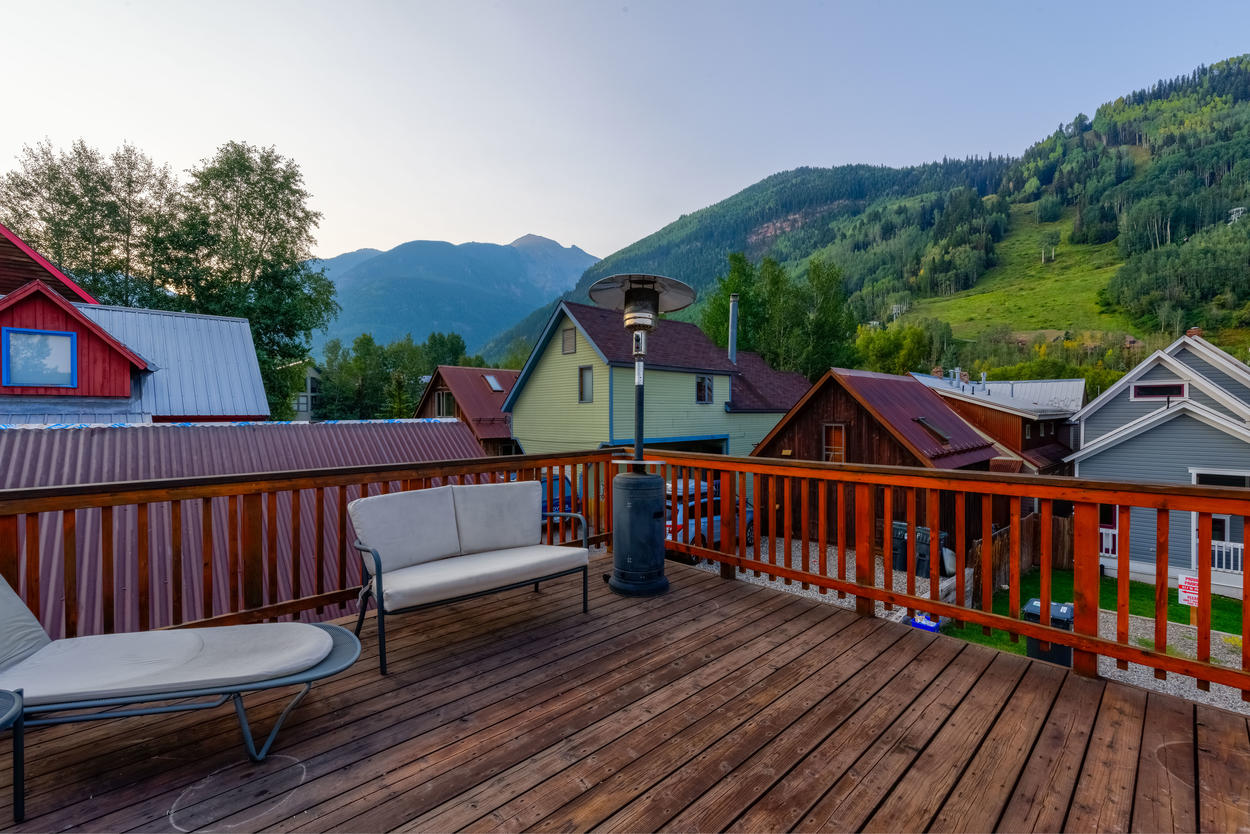 The guest house deck has spectacular mountain views.