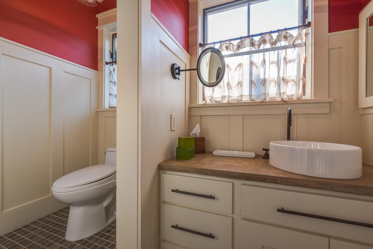 The full-size ensuite Jack and Jill bathroom has separate entrances for Guest Bedrooms 2 and 3.