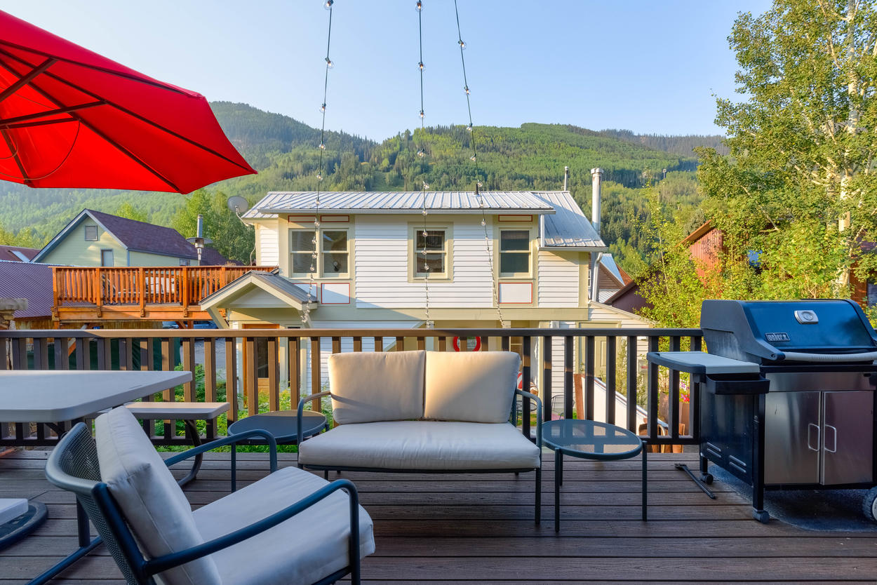 Get something going on the grill while you relax on the back porch overlooking the mountains.