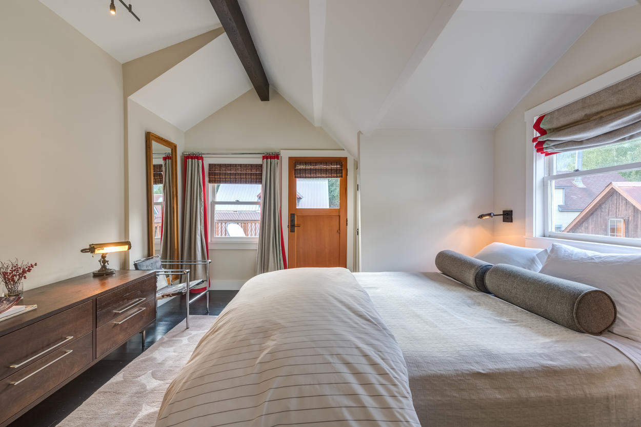 This guest room can sleep two in the queen bed.